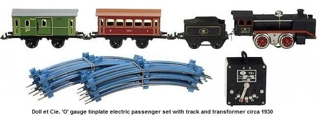 Doll et Cie. 'O' gauge electric passenger set with steam loco, tender, baggage car, pullman, track and transformer circa 1930