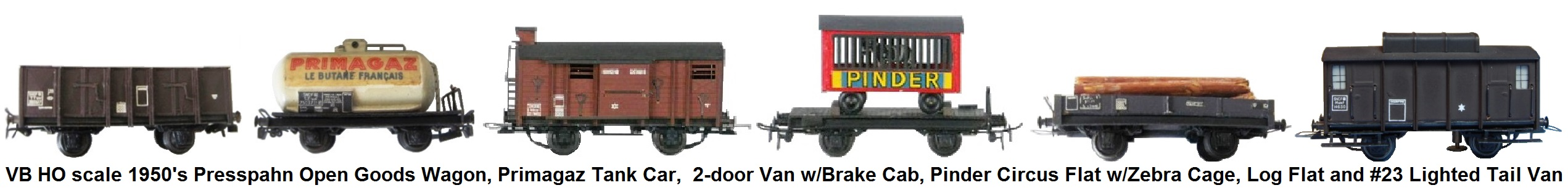 VB HO scale 1950's Presspahn Freight Wagons, includes an Open Goods Wagon, Primagaz Tank Wagon, 2-door Van with Brake Cab, Pinder Circus Flat with Zebra Cage, Log Flat and #23 Lighted Tail Van